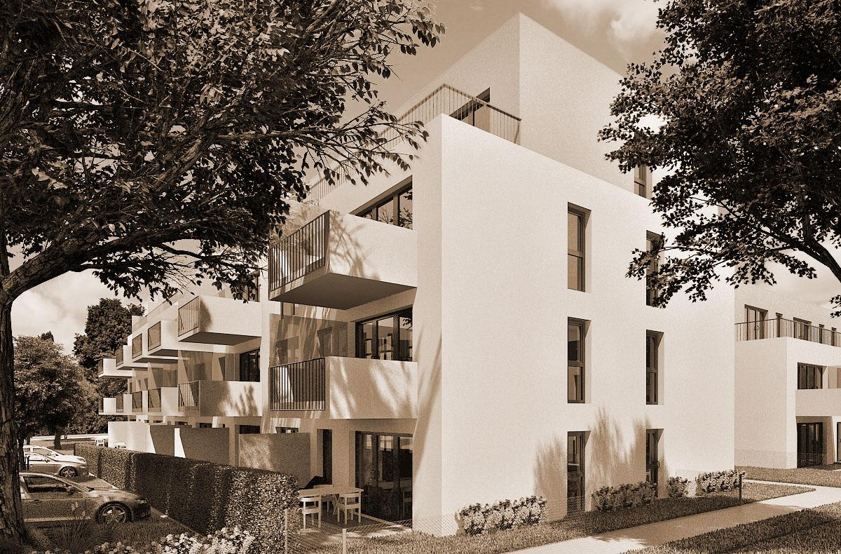 Blick auf die 4 Mehrfamilienhäuser mit 42 Wohneinheiten in Darmstadt am Washingtonplatz. Blick von der Straße auf eines der Gebäude. Balkone gliedern die Fassade.